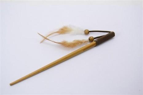 pique-à-cheveux-simple-marron-avec-plumes